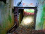 "The emergency exit (""Notausgang"") from the inside of the bunker.  Opening the thick steel door and shoveling the sand into the bunker created the escape route."